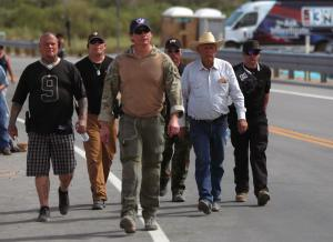 Rancher Bundy is escorted in Bunkerville